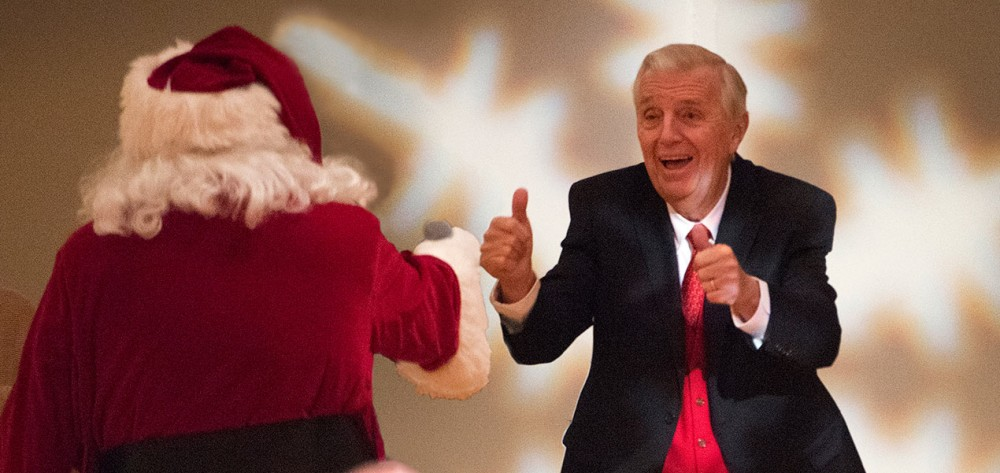Santa and Don Siekmann share a moment during the