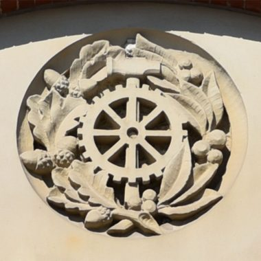 Sandstone carving representing the North or Machinery Hall