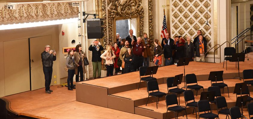 Tour Group on Music Hall's stage