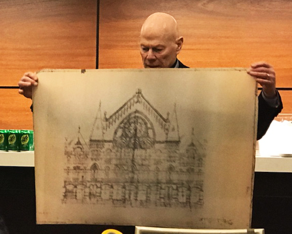Jim Tarbell holds an architectural rendering of Music Hall