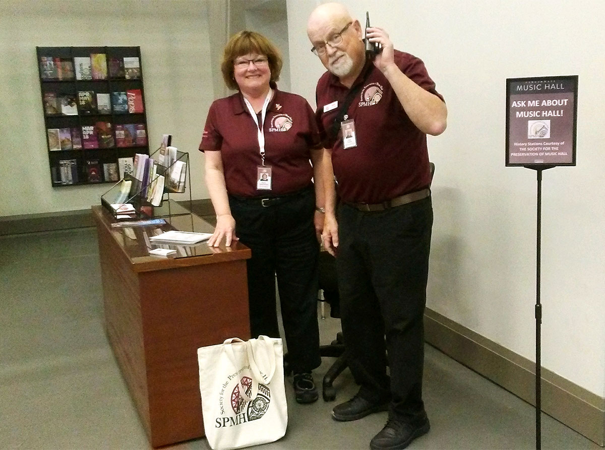 SPMH Volunteers Gayley Hautzenroeder and Dale Pepper at the Music Hall Information Desk