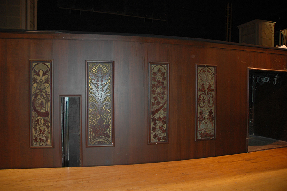 Hand-carved organ panels were hanging in the orchestra pit
