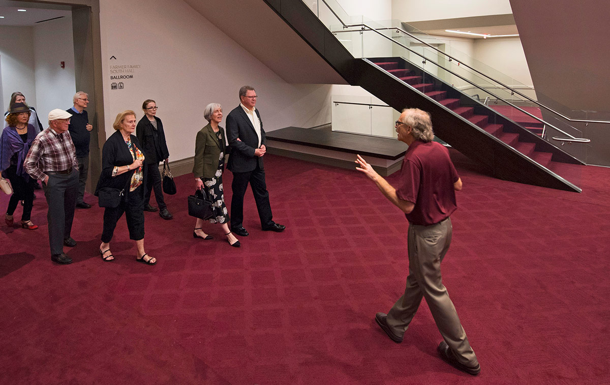 Fred Warren leads a tour group