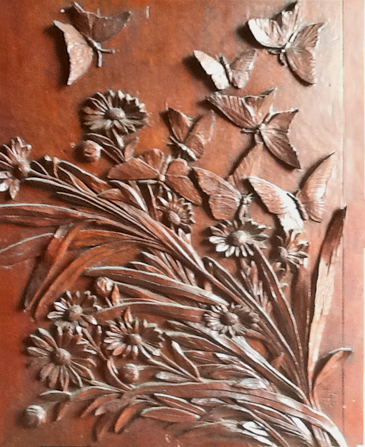 "The art-carved panel titled ""Noon"""