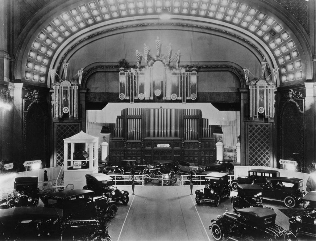 Photo showing a temporary floor in Music Hall auditorium on which cars were displayed