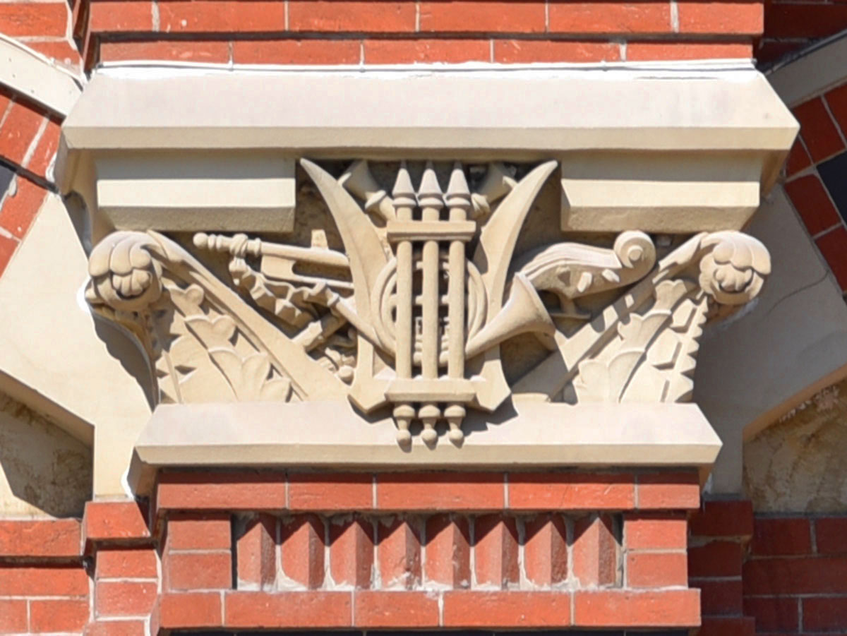 Sandstone carving of music symbols representing center
