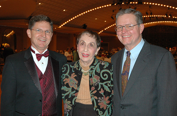 Organist Ron Rhode, President Norma Petersen, and Ron Wehmeier, expert who restored the Wurlitzer