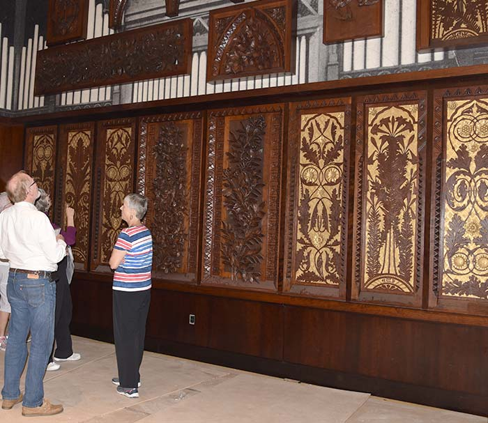 Guests taking in the art-carved panel display