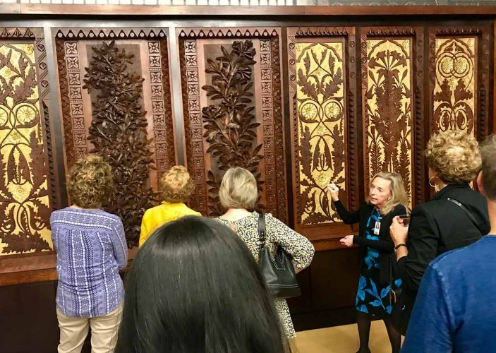 Guests with art-carved organ panels in Music Hall