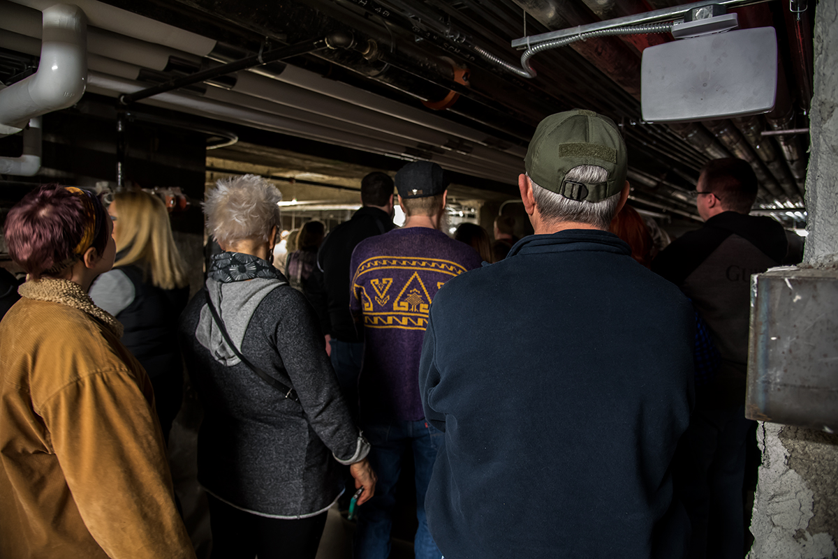 Ghost Tour group in the basement of Music Hall