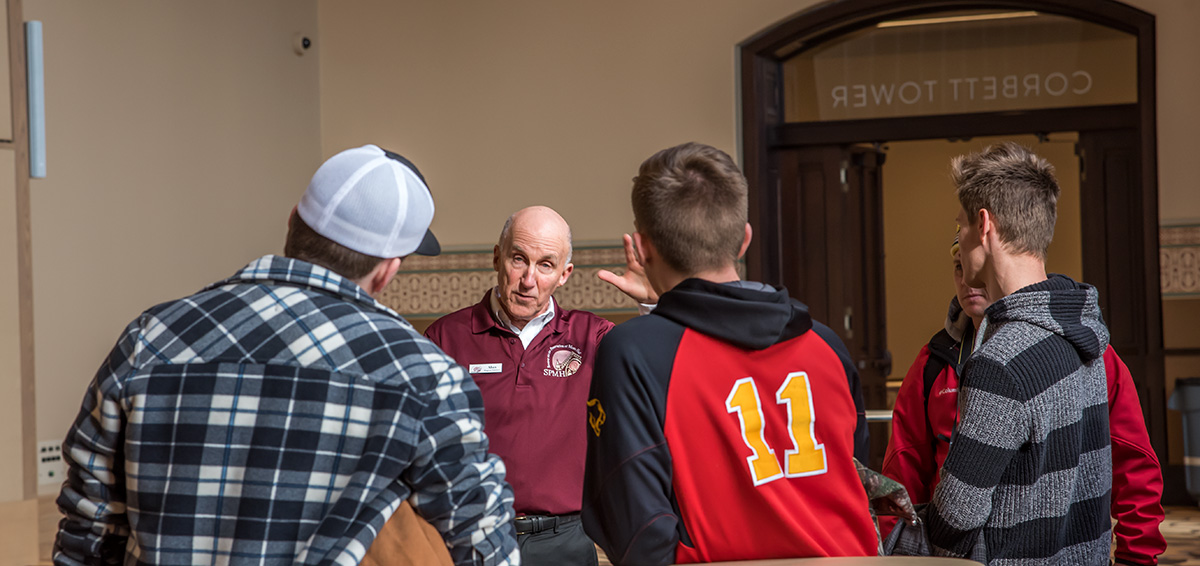 SPMH Program Guide Alan Bunker with tour participants in Corbett Tower