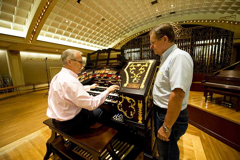 Lyn Larsen, left, and Ron Wehmeier, testing the organ before the dedication concert.