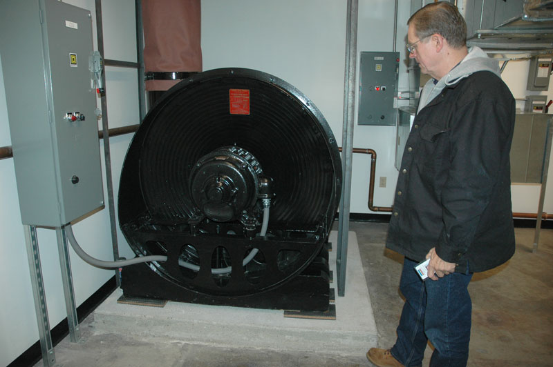 Ron standing next to the 1,700 lb. 15 HP organ blower, located 100′ from the chambers, in room designed for 70 degrees and 40 percent humidity at all times.