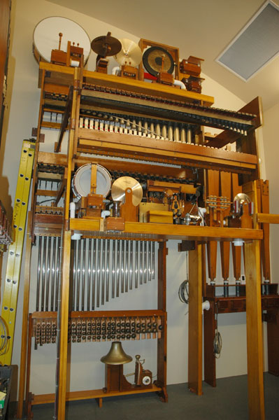 The toy counter with cymbals, tambourine, castanets, wood block, triangle, bass drum, snare drum, gong, train bell at bottom, Xylophone, Glockenspiel, Marimba, Chimes, and tuned Sleigh Bells.