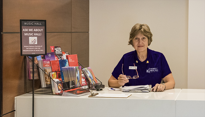 Friends of Music Hall volunteer Susan Westrick at the Music Hall Welcome Desk