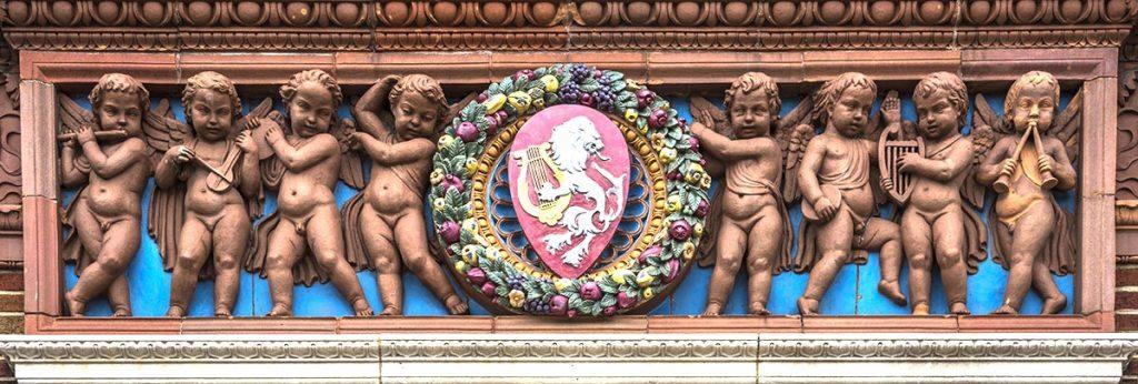 College of Music Della Robia Wreath and Lion Crest