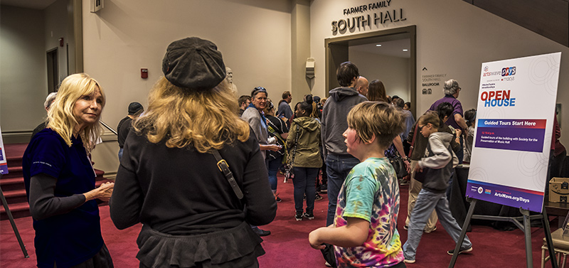 ArtsWave Open House 2019 - Friends of Music Hall Guide Becky Moeggenberg answers a guest's questions