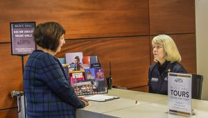 Executive Director Mindy Rosen chats with Lynne Reckman at the Information Desk at Cincinnati Music Hall