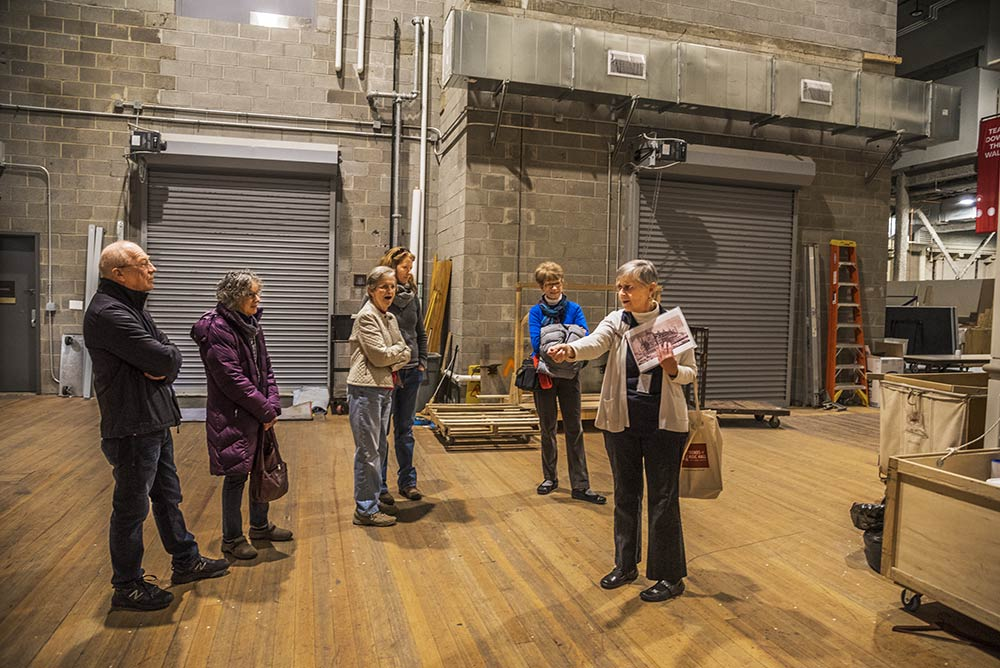 Backstage, Friends of Music Hall Program Guide Sue Monteith shares stories with her tour group
