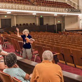 Friends of Music Hall Volunteer Patti Cruse leading a tour in Cincinnati Music Hall