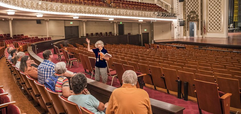 Friends of Music Hall Volunteer Patti Cruse leading a tour in Cincinnati Music Hall