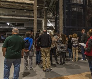 Ghost Tour guests walk through the shop backstage, in the area that at one time held exhibits in the North Hall.