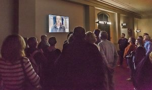 Ghost Tour guests listen as one man describes his encounter in Cincinnati Music Hall.