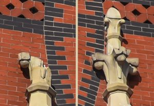 Left-Broken Finial & Right-Only Complete Sandstone Finial, Near Rose Window