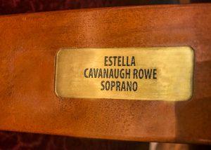 """Estella Cavanaugh Rowe"" brass plaque on orchestra right, row N, seat 302"