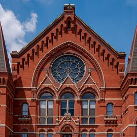 Cincinnati Music Hall showing four restored fnials and, in the center, restored spikes on the lyre above the date stone