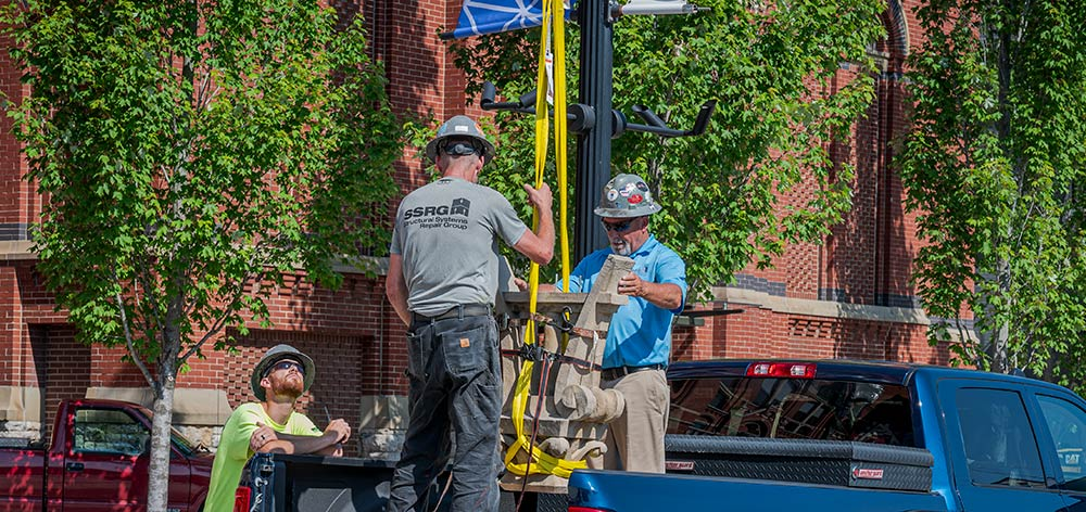 Cincinnati Music Hall SSRG team securing the lyre before the crane moves it into position