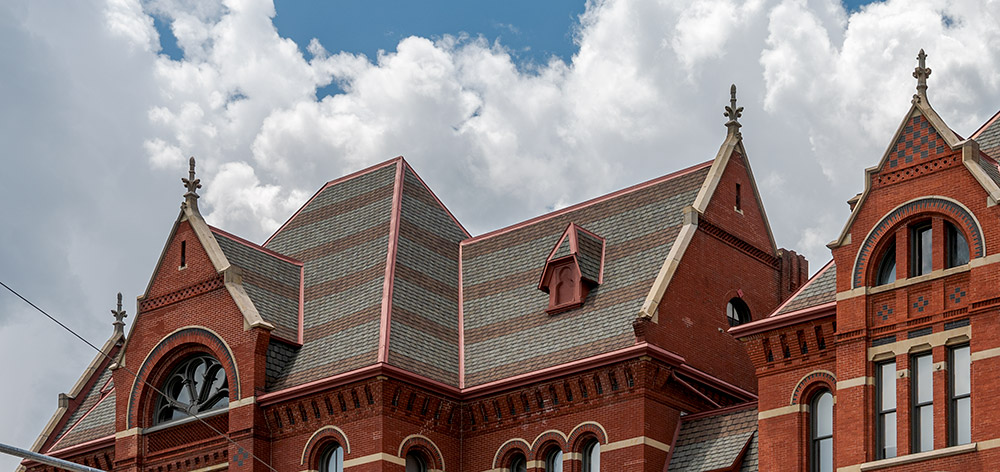 At the end of the second day of finial installation, restored finials can be seen on the east facade of Cincinnati Music Hall