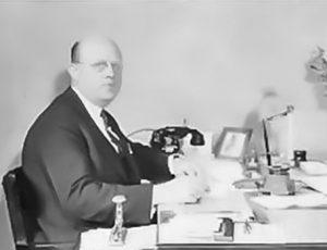John J. Behle at his desk