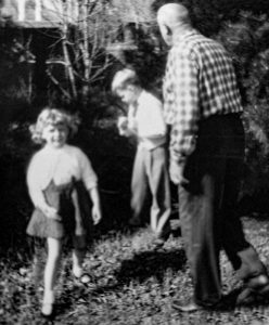 Becky Moeggenberg with her grandfather, John J. Behle, 1954